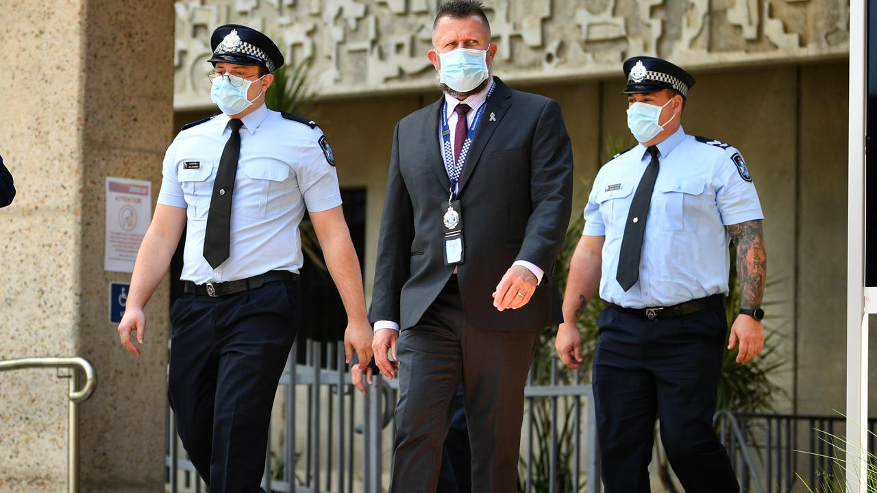 Constable Zachary Schembri (front) & Constable Shane Warren leave the Townsville Courthouse after giving evidence at an inquest. Pictured with Queensland Police Union representative. Picture: Alix Sweeney