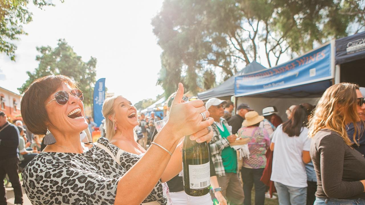 Popping a bottle at the Relish Food and Wine Festival