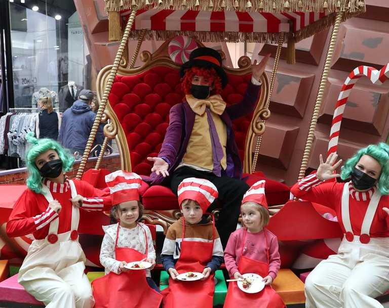 Grand Central School Holidays - The Candy Academy. Marlee Hawkins 5, Elliot Hartshorn 6 and Penny Hartshorn 3 show off their sweet treat while they meet Willy Wonka and his Oompa Loompas.