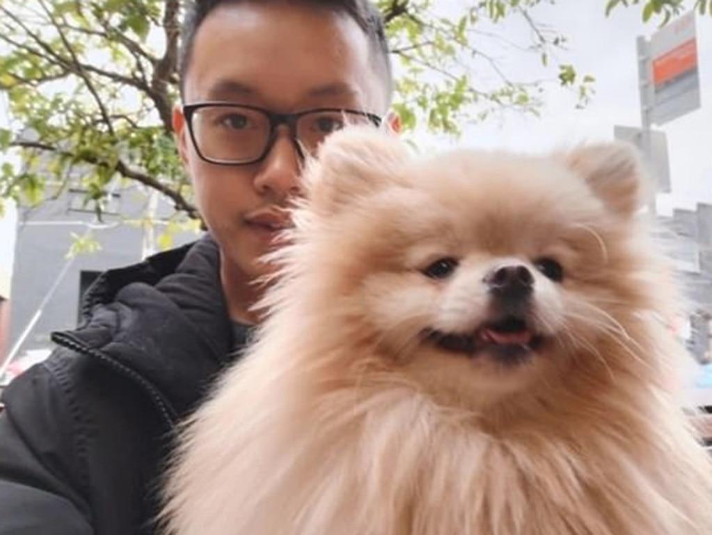Mr Chow with Kobe the dog.