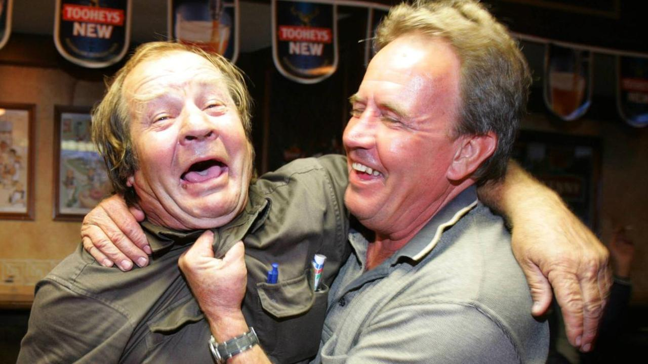 Tommy Raudonikis hams it up with his old footy foe and good mate Greg Oliphant.