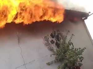 Cops rescue mum and child from blaze