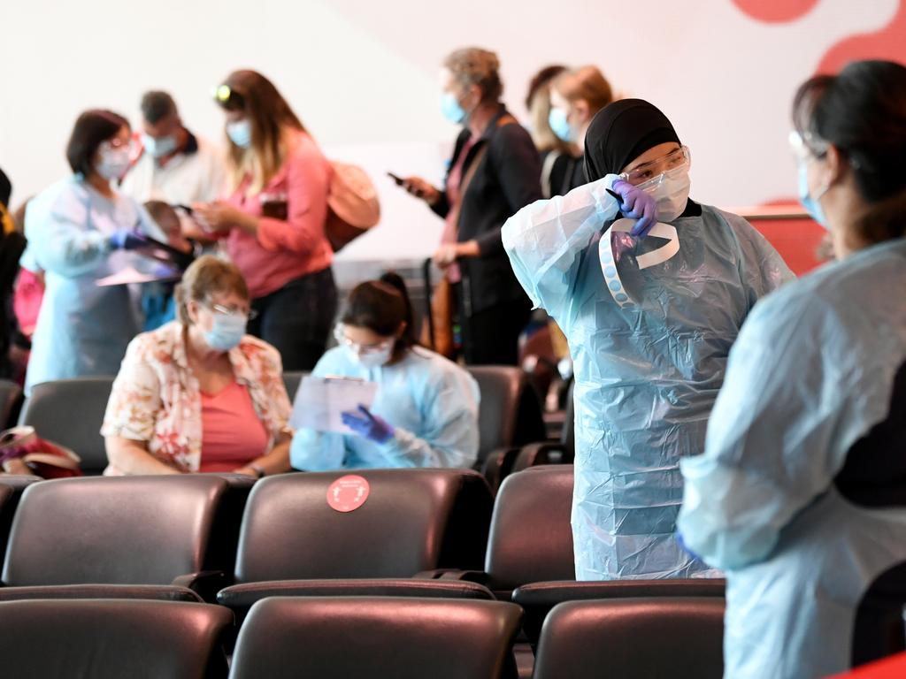 Returning passengers from Brisbane are screened at the arrivals gate in the Qantas Terminal at Sydney airport. Picture: NCA NewsWire / Jeremy Piper