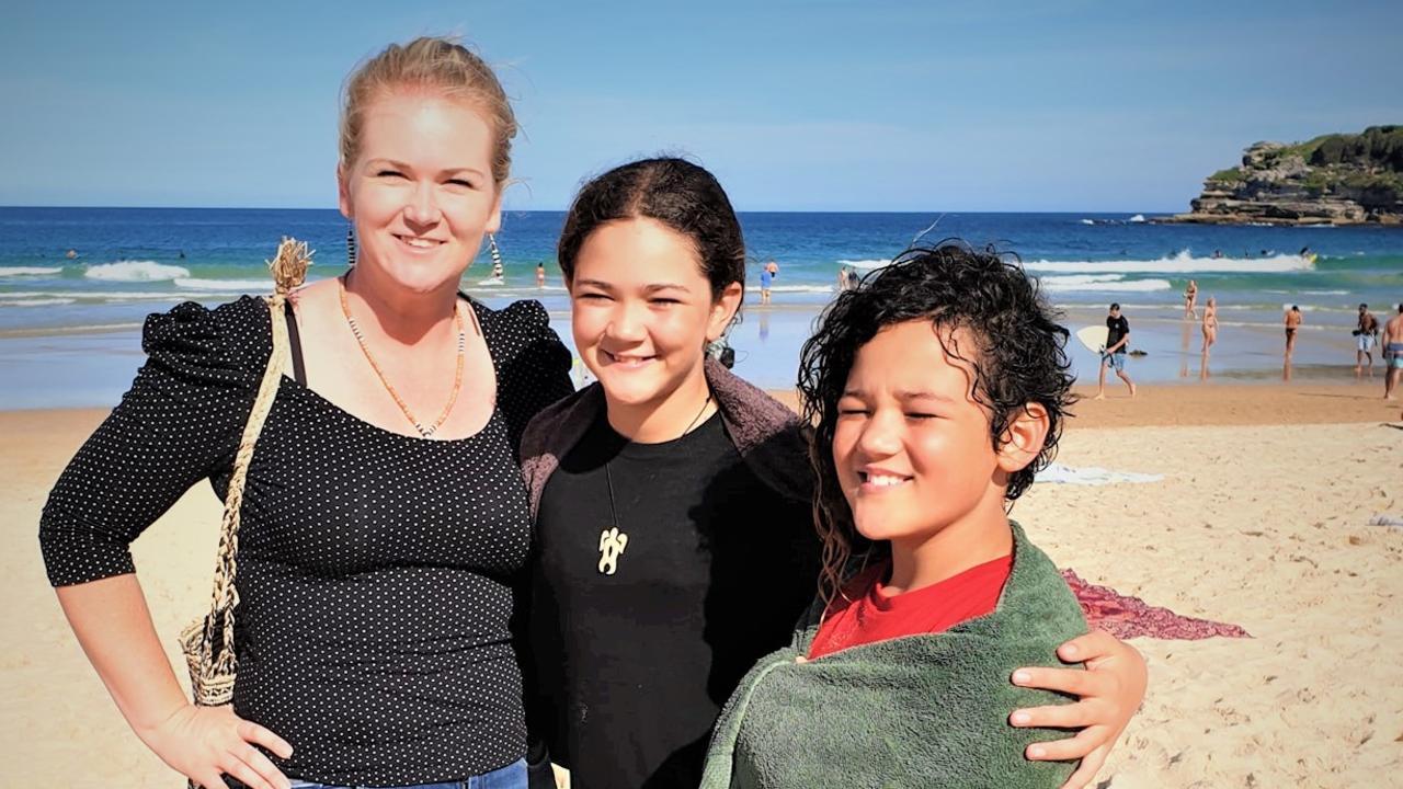 Mum Kylie Travers with daughters Halia and Mele Ofiu at Bondi Beach