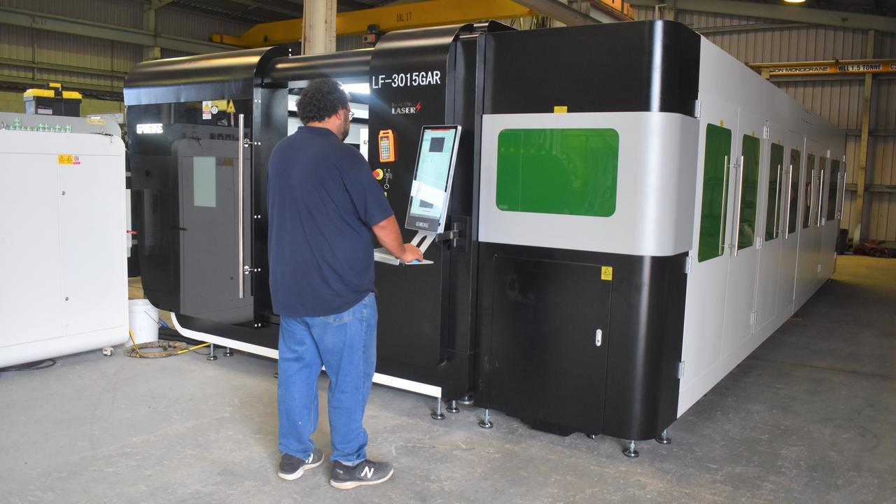 Simeon using the G Weike laser machine.
