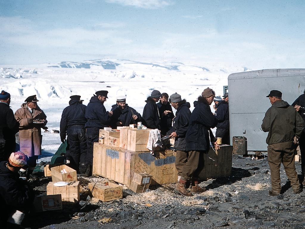 Members of the Commonwealth Trans-Antarctic Expedition, which included Prince Philip, take a meal break in a photo circa 1956-58. Picture: Supplied
