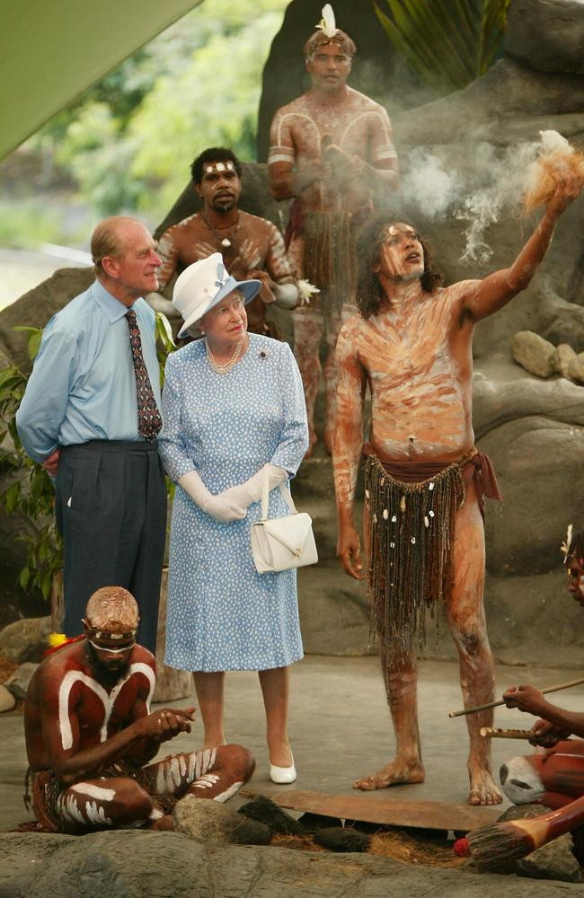 The Queen and Prince Philip meet with Indigenous performers in Cairns in 2002. Picture: AFP