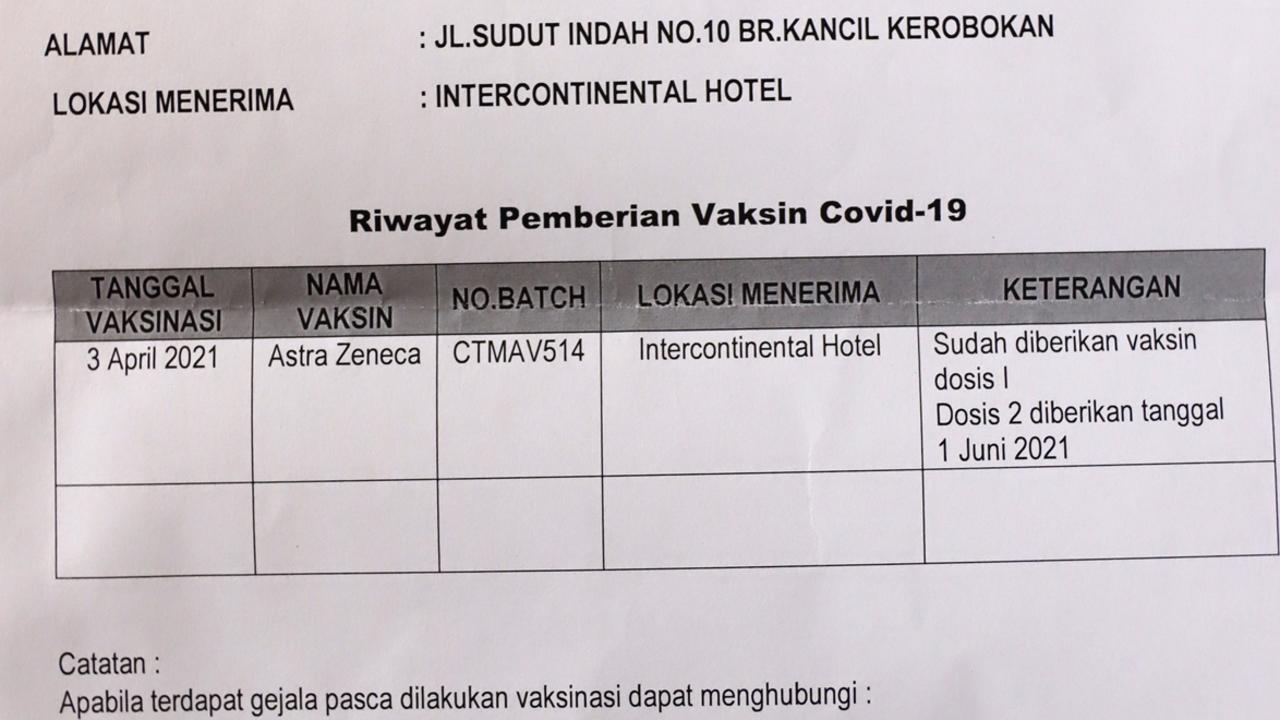 Australian Margaret Barry's confirmation of her Astra Zeneca vaccine in Bali. Picture. Lukman S. Bintoro