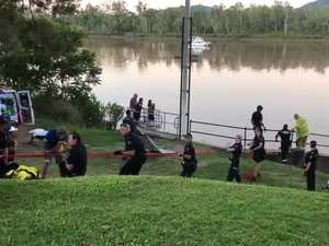 Emergency services rescue woman from Fitzroy River drain