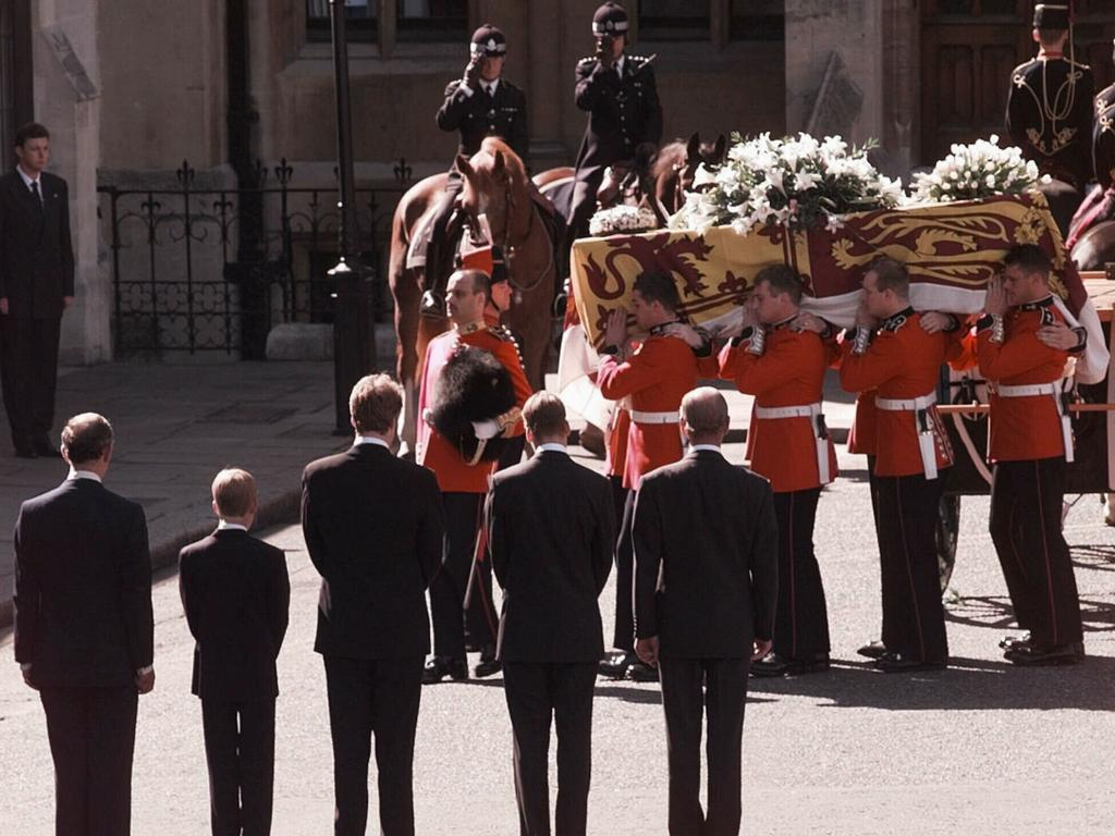 Earl Spencer, Prince William, Prince Harry, Prince Charles and Prince Philip wait as the coffin of Diana, Princess of Wales, is carried by Welsh guardsmen into Westminster Abbey, London, for her funeral service in 1997.