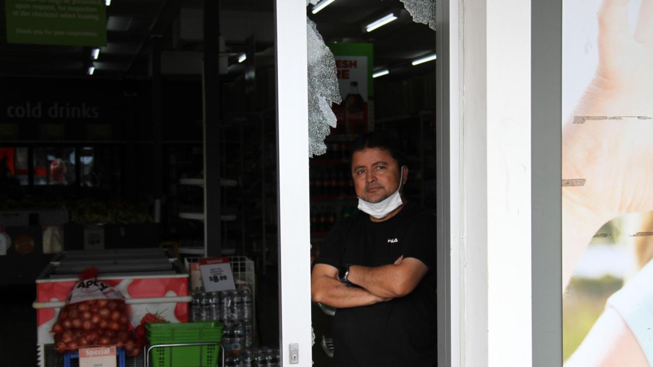 Manager Zafar Aziz shows the damage where a thief smashed into West Gladstone Foodworks just after 4am on April 11. Picture: Rodney Stevens