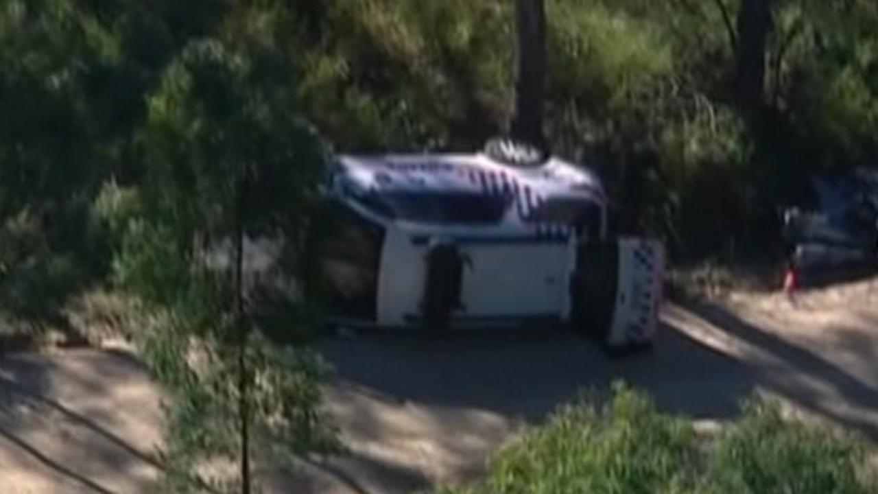 Brett Forte police vehicle, which rolled as he was attempting to escape Ricky Maddison's gunfire. Picture: Channel 7