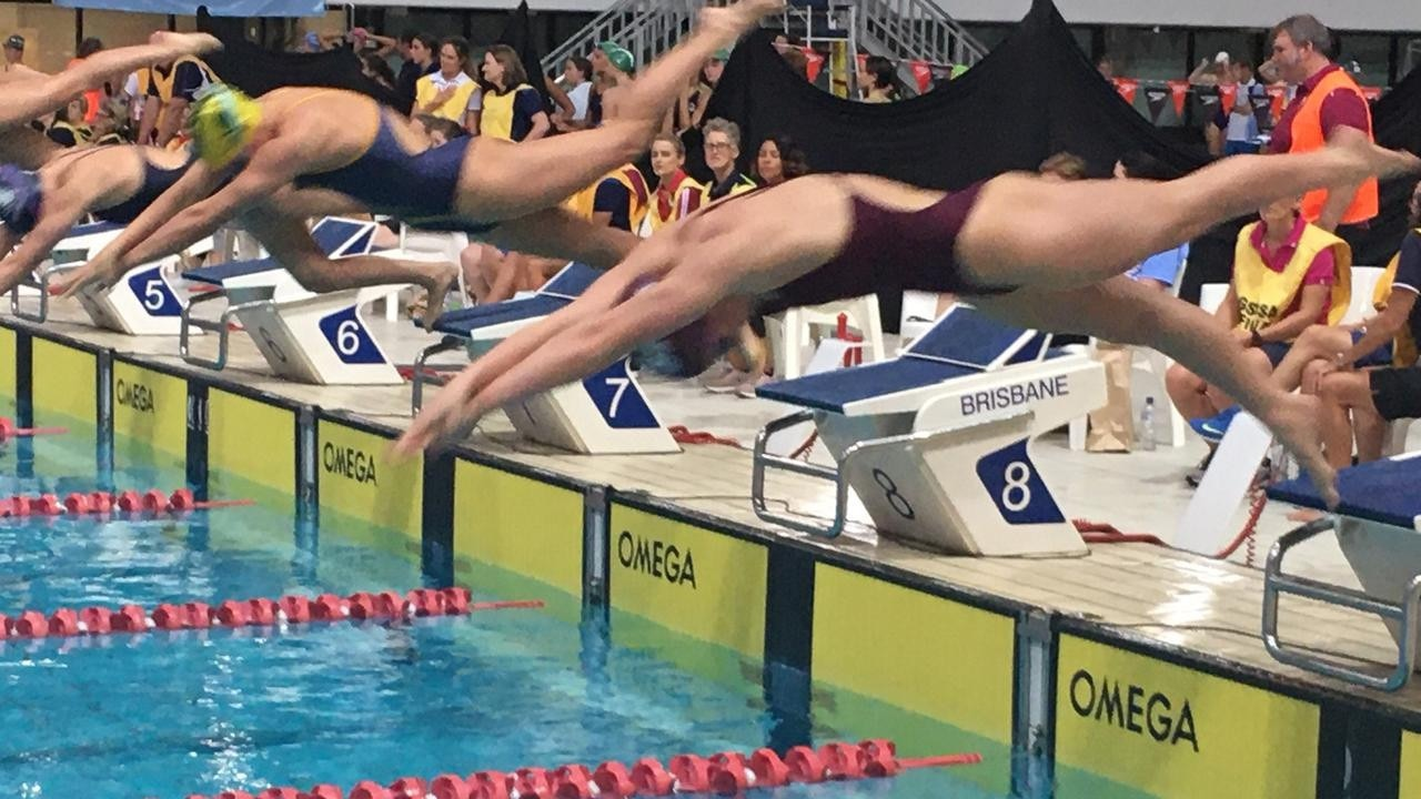 Mollie O'Callaghanclosest to camera, will swim at the open nationals.