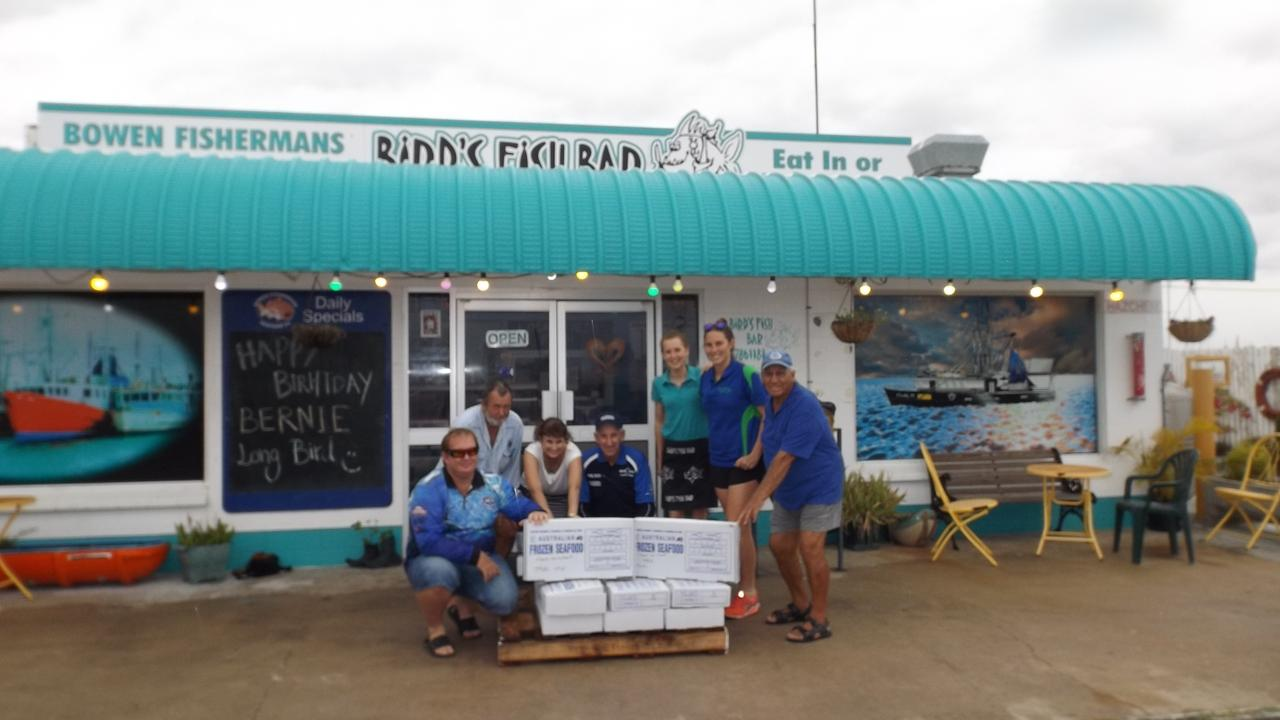 Phillip Hines, Russel Hines, Sharon Bradford and Russell McCabbin from the Bowen Fishing Classic with Bird's Fish Bar's Chloe Bauer and Jessica Cabot and Meals and Wheels' Ken Carters with the 14 cartons of fillets donated in 2017. Picture: File