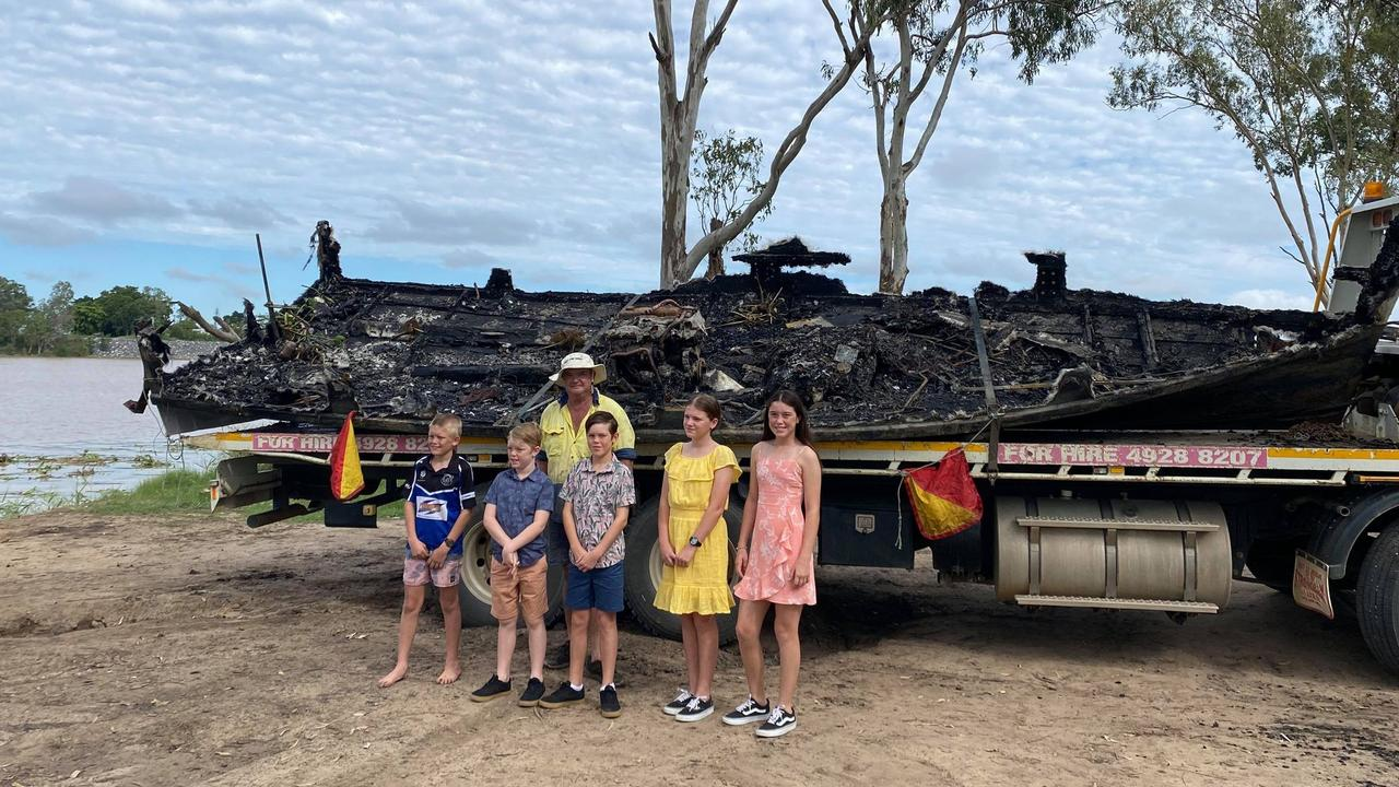 Mark Prosser's boat Old Dunn was destroyed in an arson attack on Friday April 9. Pictured with his grandchildren Xavier, Darius, Ari, Charlotte and Ainsley.