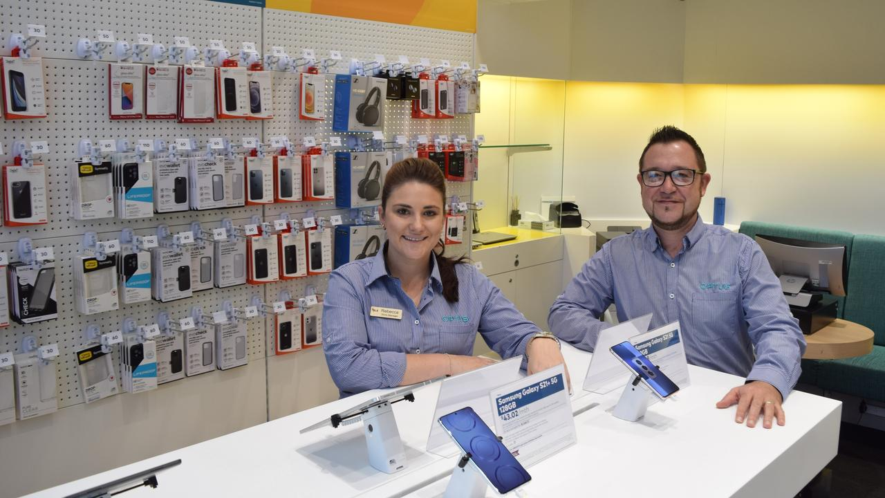 Store manager Bec Green and Garry Clarke (Optus Local Channel & Execution Manager for Central Queensland) and the official opening of Optus' new Emerald store on April 12, 2021. Photo: Kristen Booth