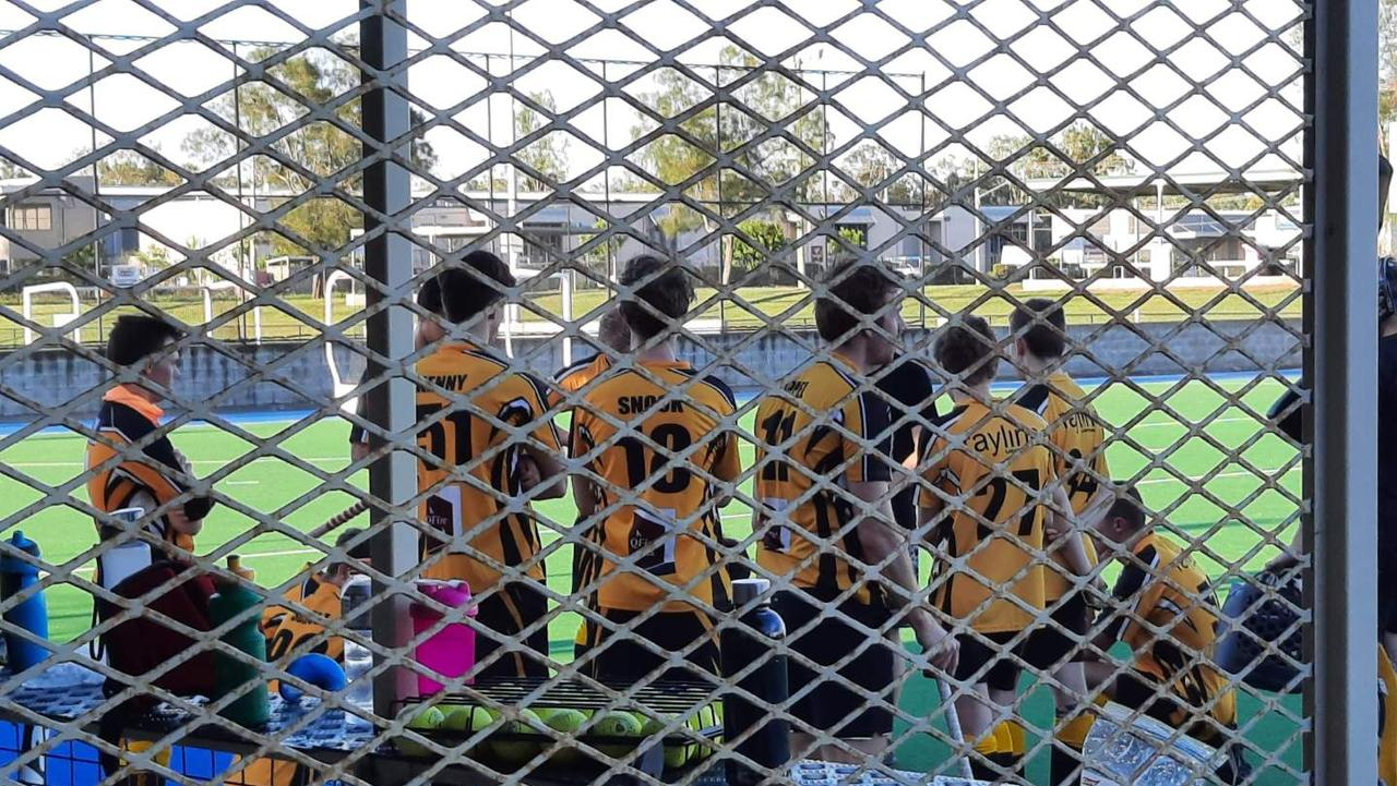 Easts A-Grade players discuss tactics during a break in play at the Ipswich Hockey Centre. Picture: David Lems