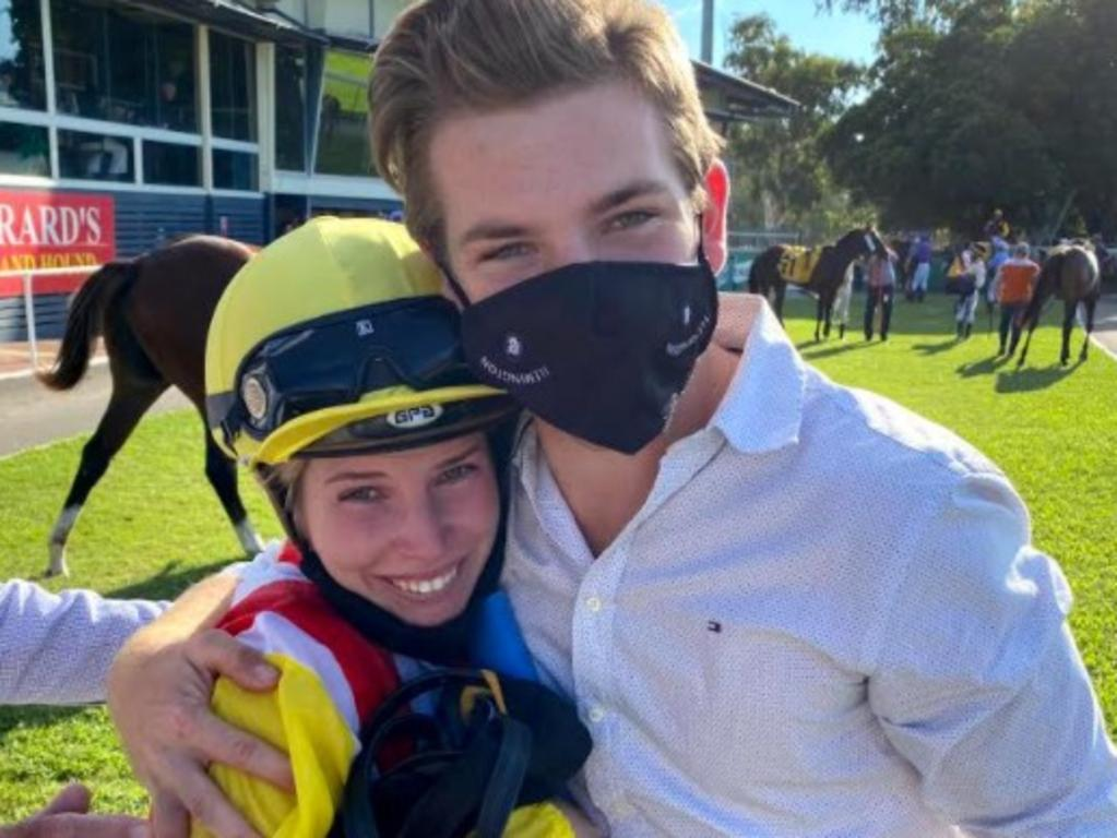 Jockey Elyce Smith and trainer Thomas Smith celebrate after Natural Emperor's win in the $93K CYS 3 & 4YO Championship (1300m) on Saturday. Photo: Tony McMahon.