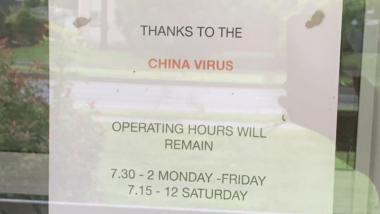 A Gold Coast barber has defended a sign blaming the 'China virus' for reduced operating hours.
