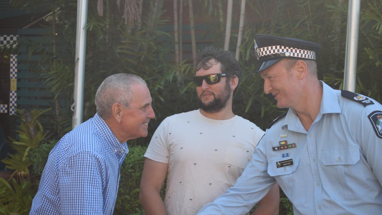 Peter Corke thanking Gladstone Police acting senior sergeant Brad Foat