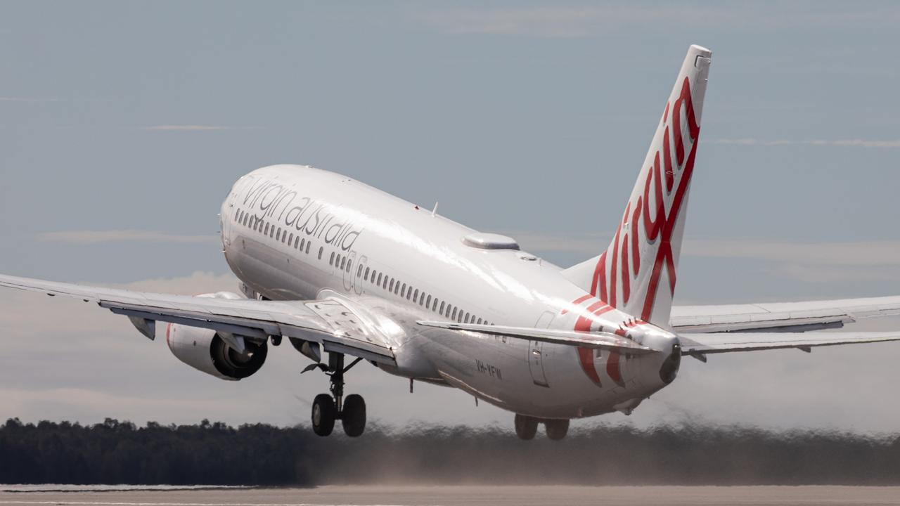 Brisbane Airport Corporation second runway opening in July last year. Residents say BAC new flights over the Bay were not realistic. Picture: Beau Chenery
