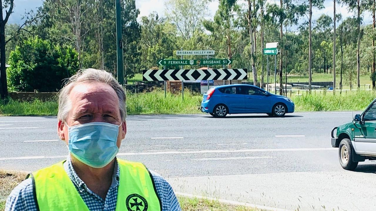 Ipswich West MP Jim Madden at the Glamorgan Vale Road intersection of the Brisbane Valley Highway