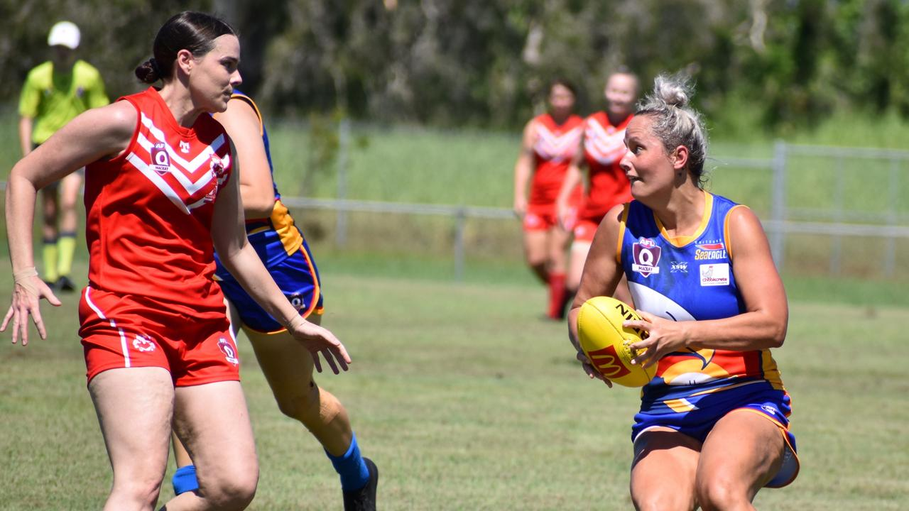 Whitsunday Sea Eagles player Erica McIntosh takes on the Swans opposition. Picture: AFLQ Mackay Josh Rhodes