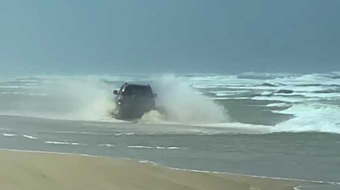 WATCH: Driver steers car into waves on Fraser Island