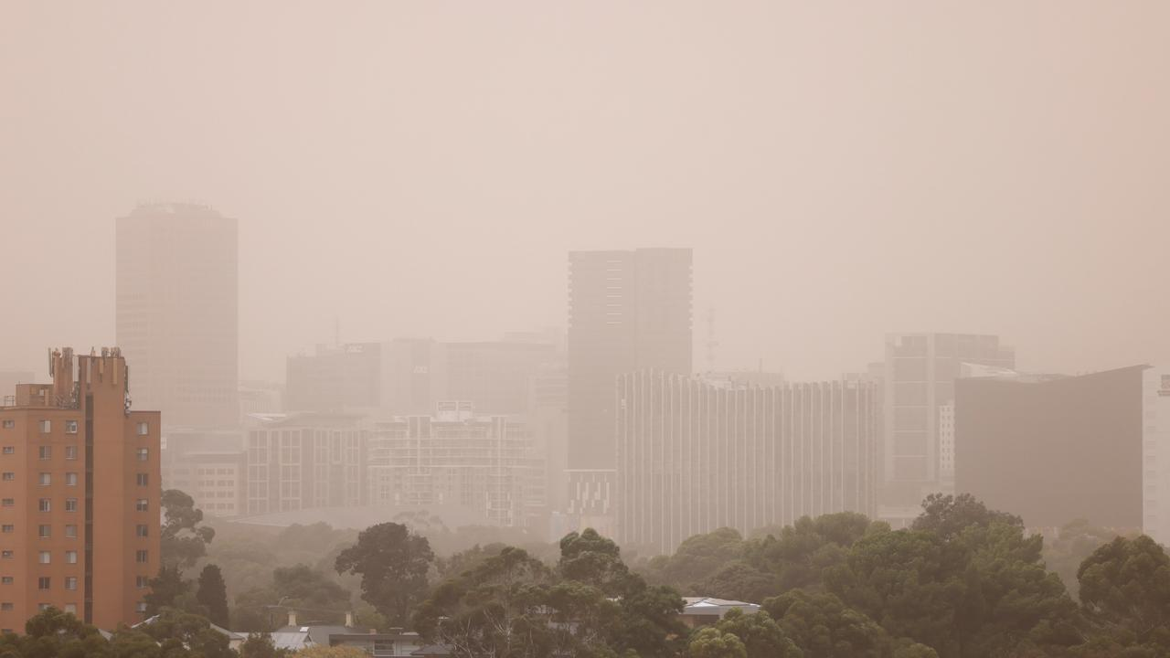 A warning has been issued for strong winds in South Australia after gusts stirred up dust and left many areas in an orange haze.