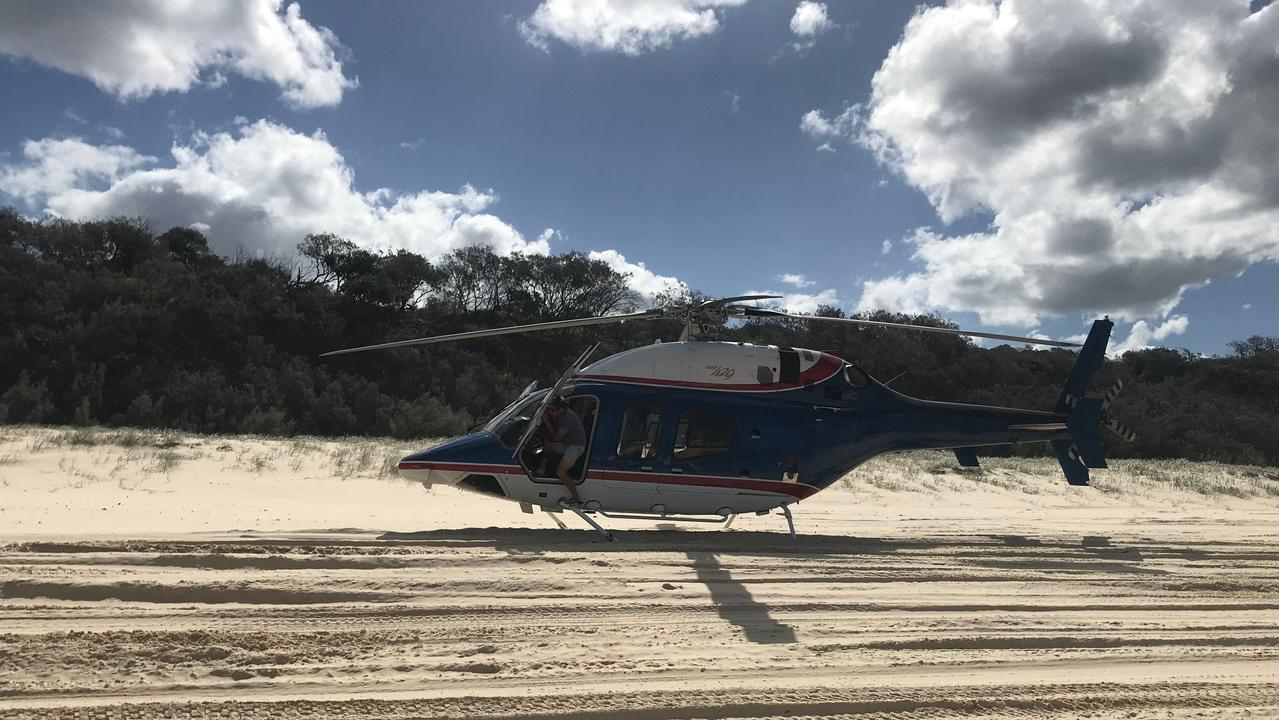 A pilot was fined after landing a helicopter illegally on Fraser Island.