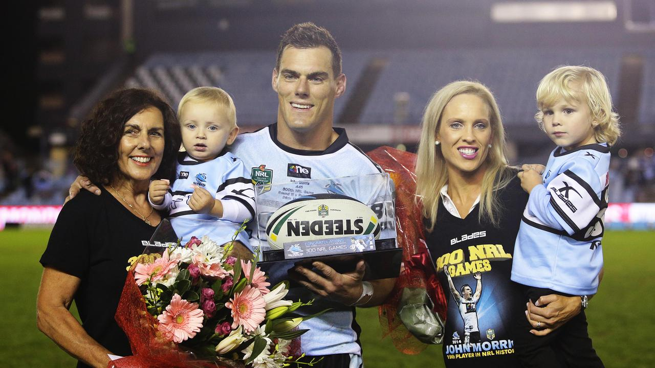 Cronulla's John Morris after his 300th NRL game with mother Sharyn, son Taj, wife Michelle and son Cruz. Picture: Brett Costello
