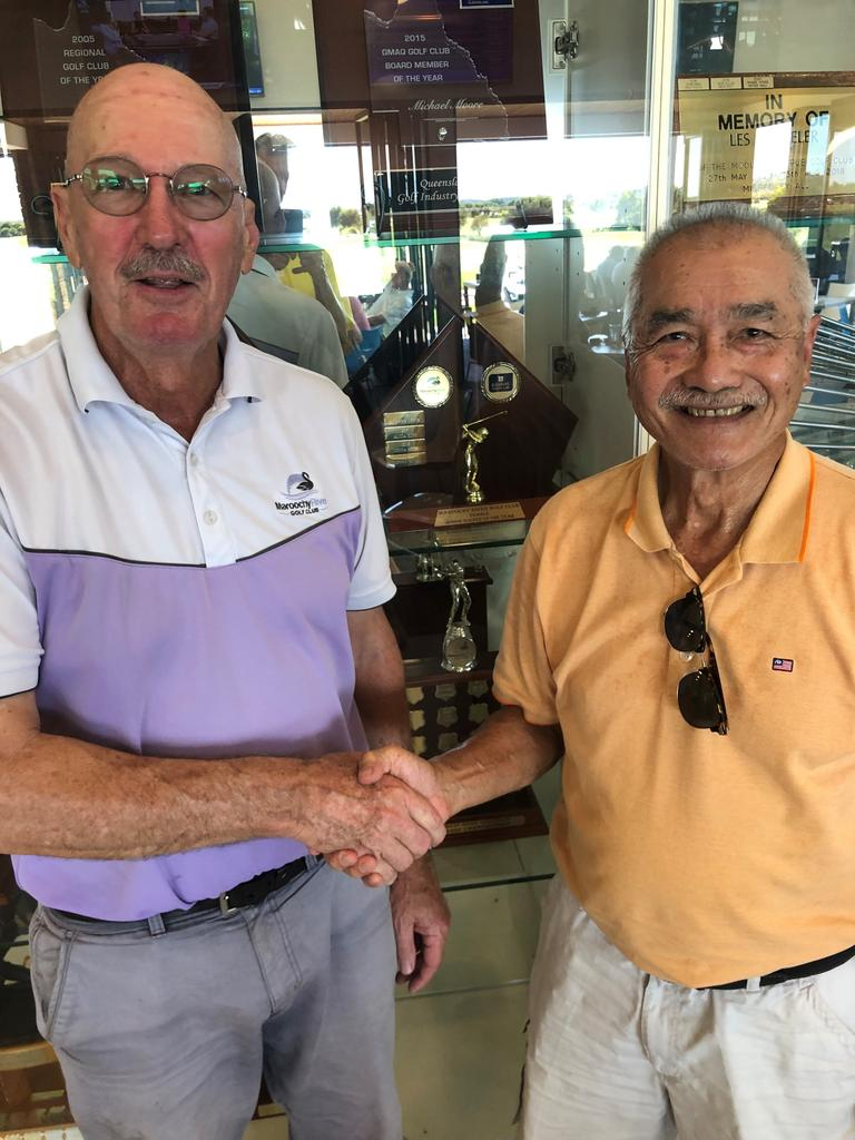 Frank Chong (right) congratulates Leigh Lasek on his extraordinary round of 47 stableford points at Maroochy River
