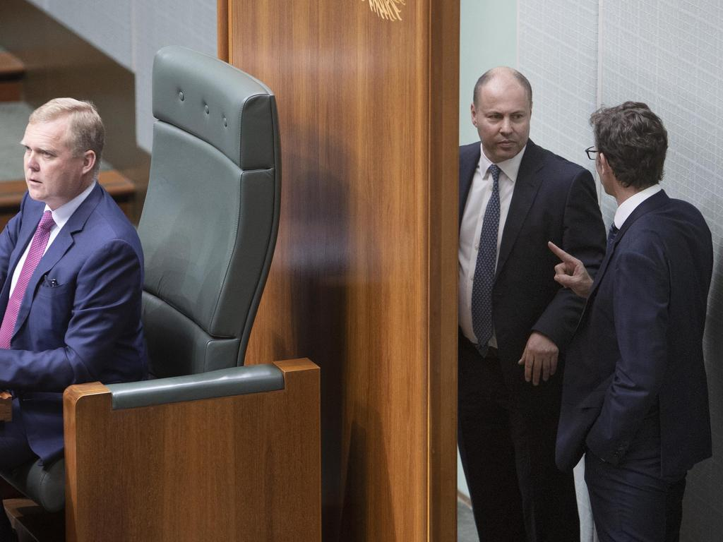 Treasurer Josh Frydenberg and Stephen Jones exchange words behind the speaker's chair in the House of Representatives. Picture: NCA NewsWire / Gary Ramage