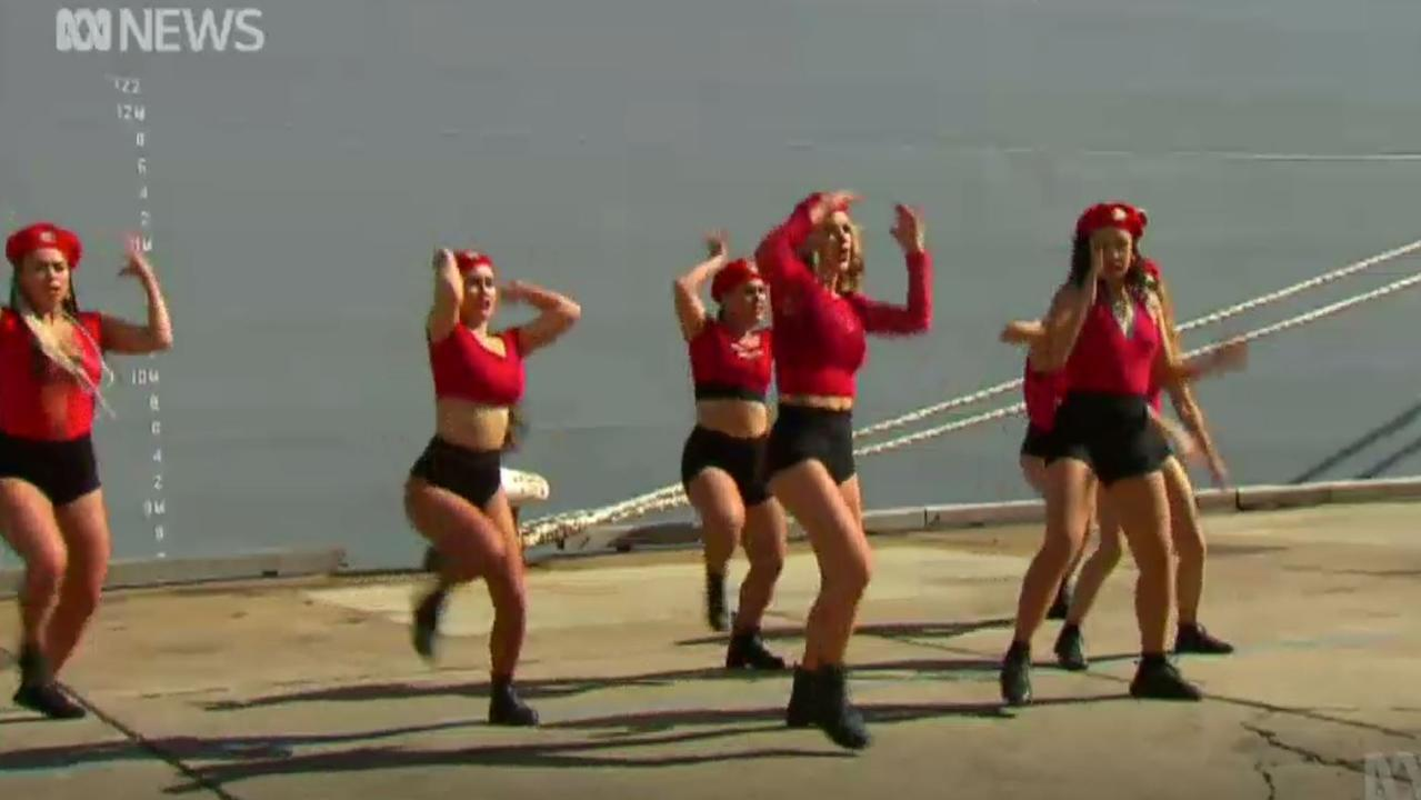 The Royal Australian Navy organised dancers to help formally commission the HMAS Supply. Picture: ABC