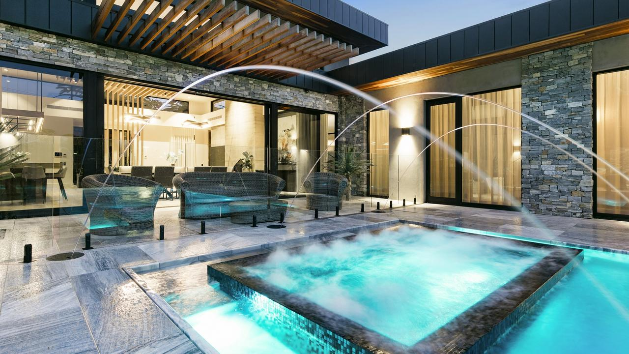 A basement lounge and bar looking into the pool — and a $150K oven. This sure ain't van life anymore.