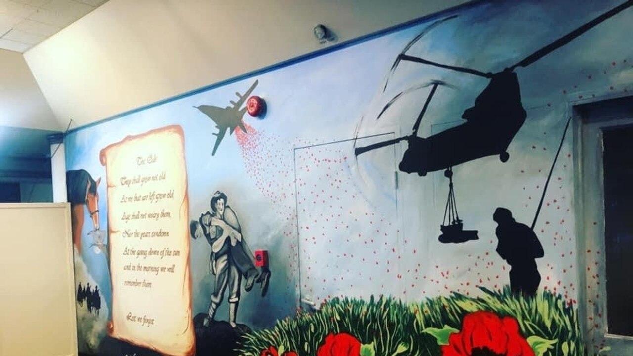 Warwick veteran Tina Neal spent weeks painting these memorial murals in the RSL foyer.