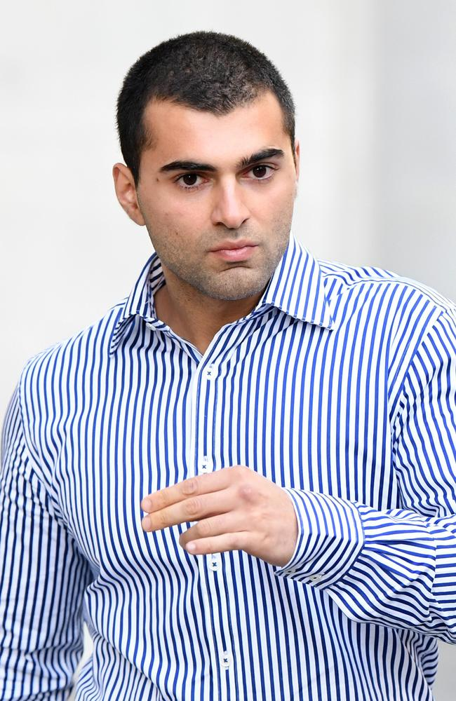 Ali Ebrahmi leaves the District Court in Brisbane. Ebrahami and his co-accused, former The Block contestant Suzi Taylor are on trial for alleged extortion, deprivation of liberty, attempted robbery and fraud. Picture: NCA NewsWire / Dan Peled