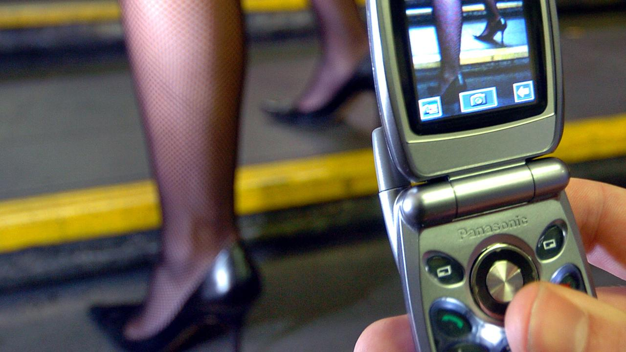 19 Jul 2004 /Melbourne Mobile user, using his phone in a questionable way. generic camera screen view pervert woman's legs photographing