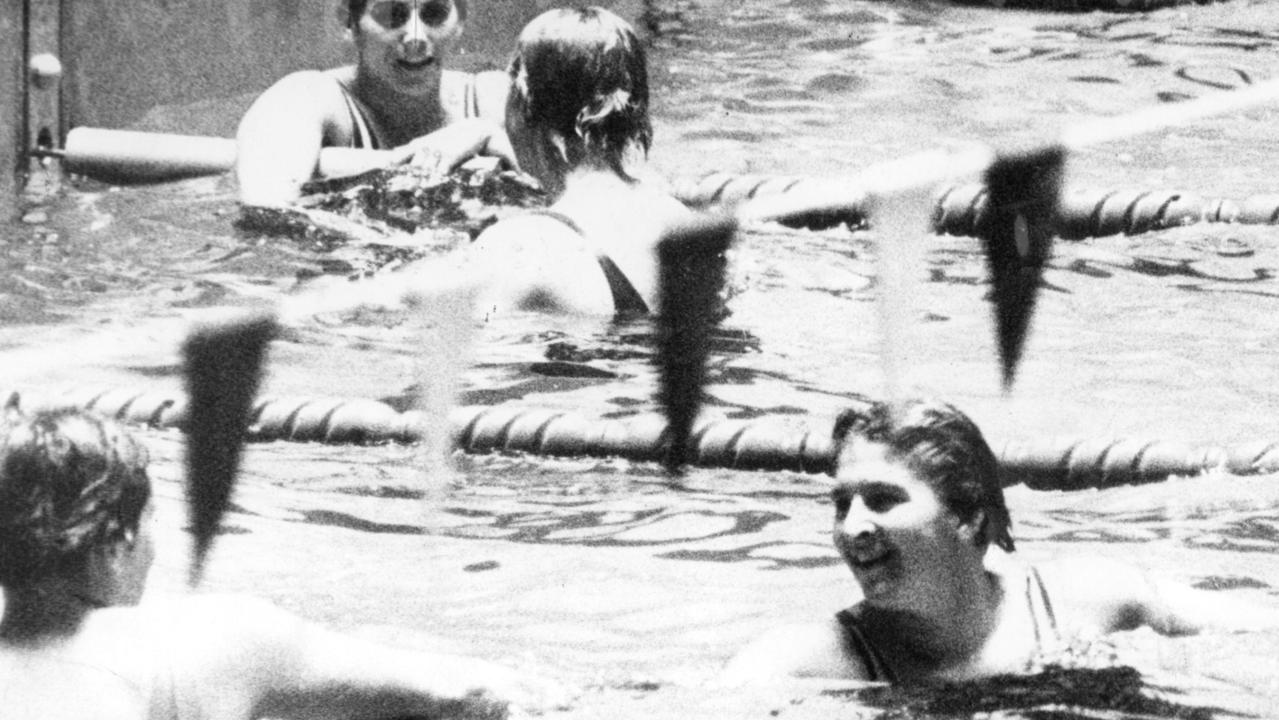 Stroke of genius: Dawn Fraser being congratulated after setting a new Olympic record to win the women's 100m freestyle final in Tokyo.