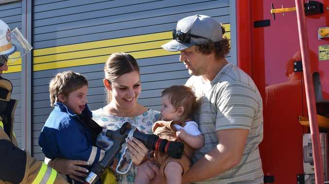 Little Grayson living out his dream with firefighting family