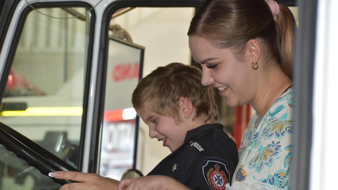 Honorary firefighter Grayson Little with his mum Rachel Little at the Mackay fire station. Picture: Lillian Watkins