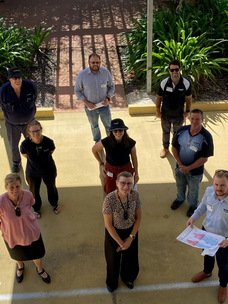 Hutchinson Builders and Benevolent Living staff discuss the project. Sue McLeod, Alison Moss, Nick Linnan, Helen Cleary, Olivia Di Pasquale Steele Wrobel, Greg Inwood, Gary Pitcher, Tristan Nicol and Damien Mills.
