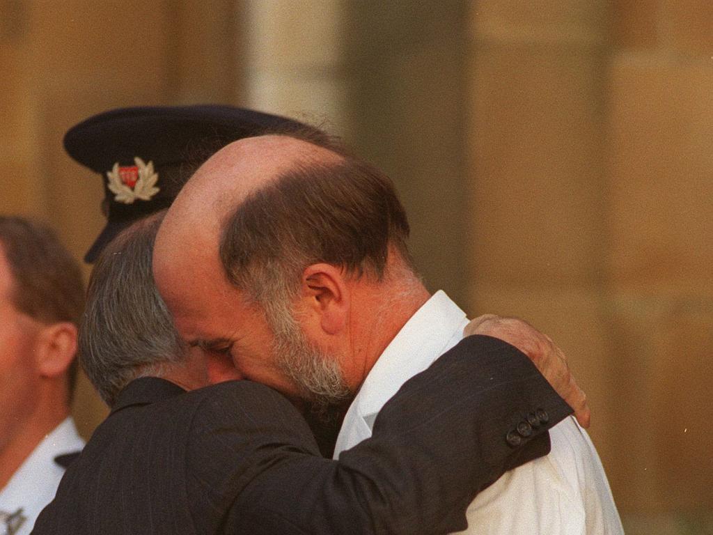 Dr Bryan Walpole hugs then PM John Howard.