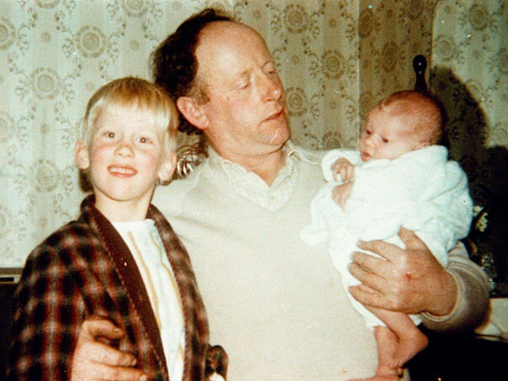 Martin Bryant as a child with father Maurice and baby sister Lindy.