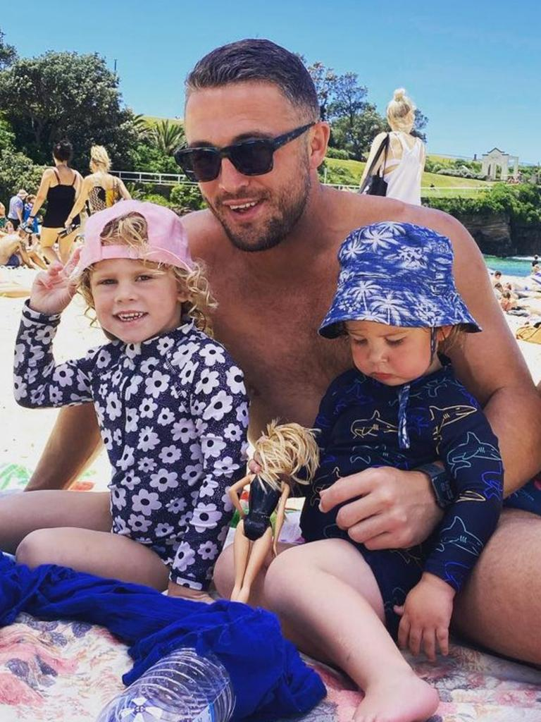 The former NRL star with his kids at Coogee beach.