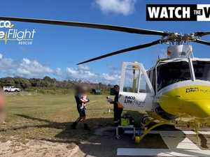 QAS rescuing 2 year old boy attacked by Dingo on Fraser Island