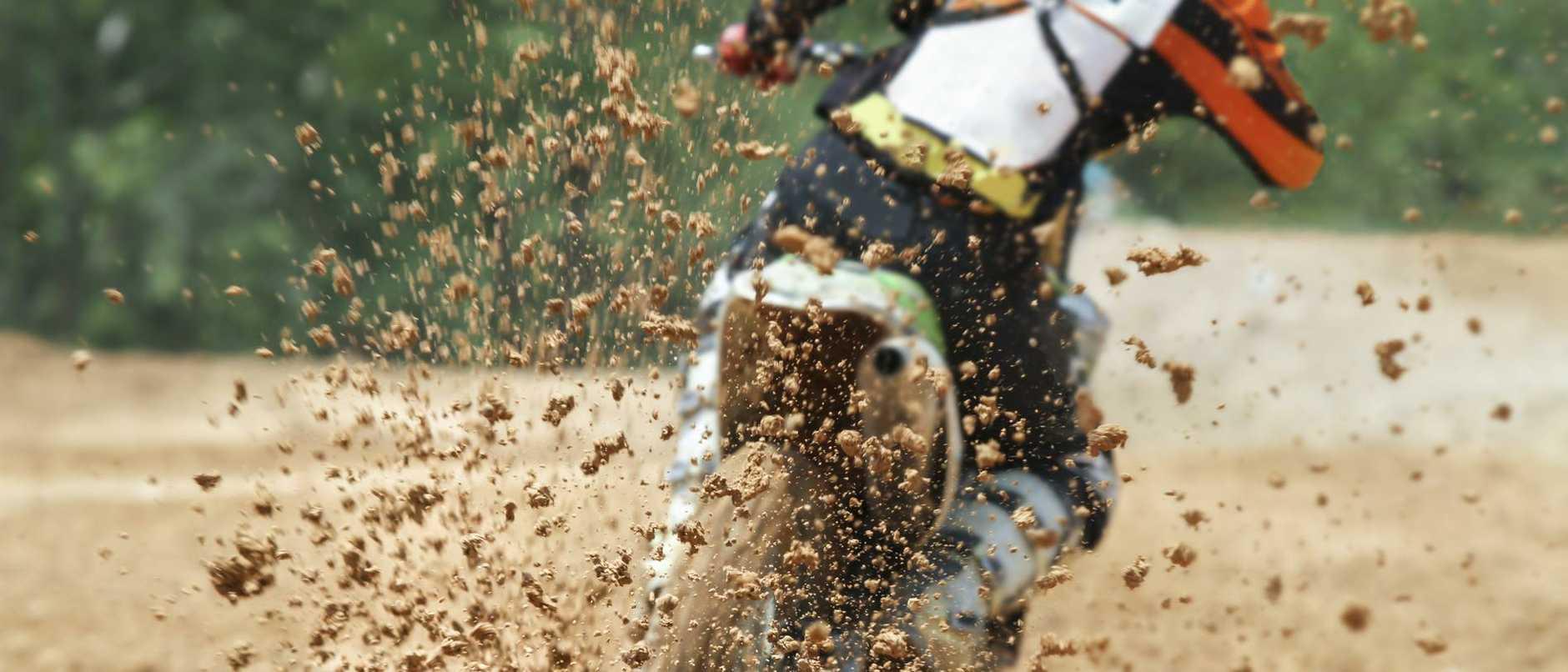 Mud debris flying from a motocross race