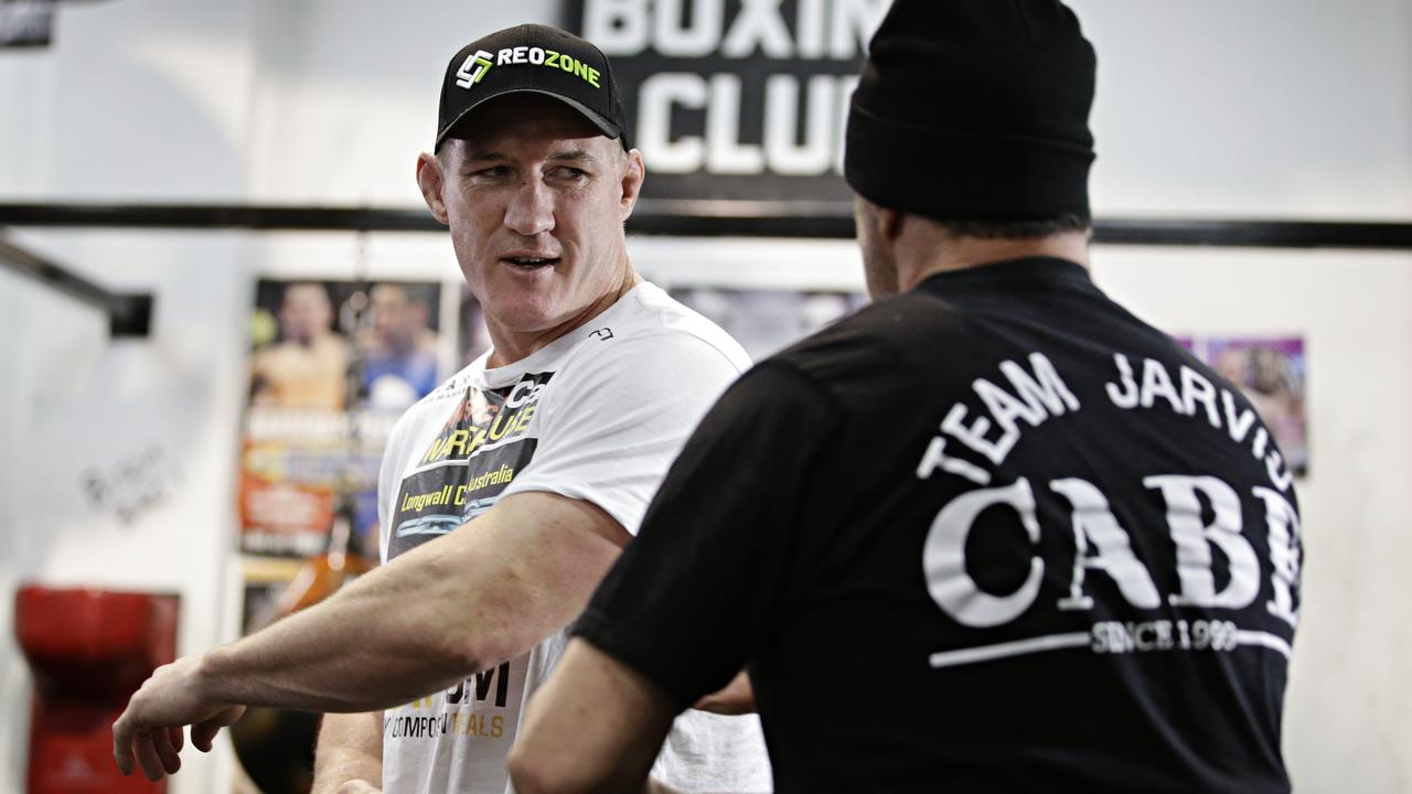 Paul Gallen gets some words of advice from Jeff Fenech.