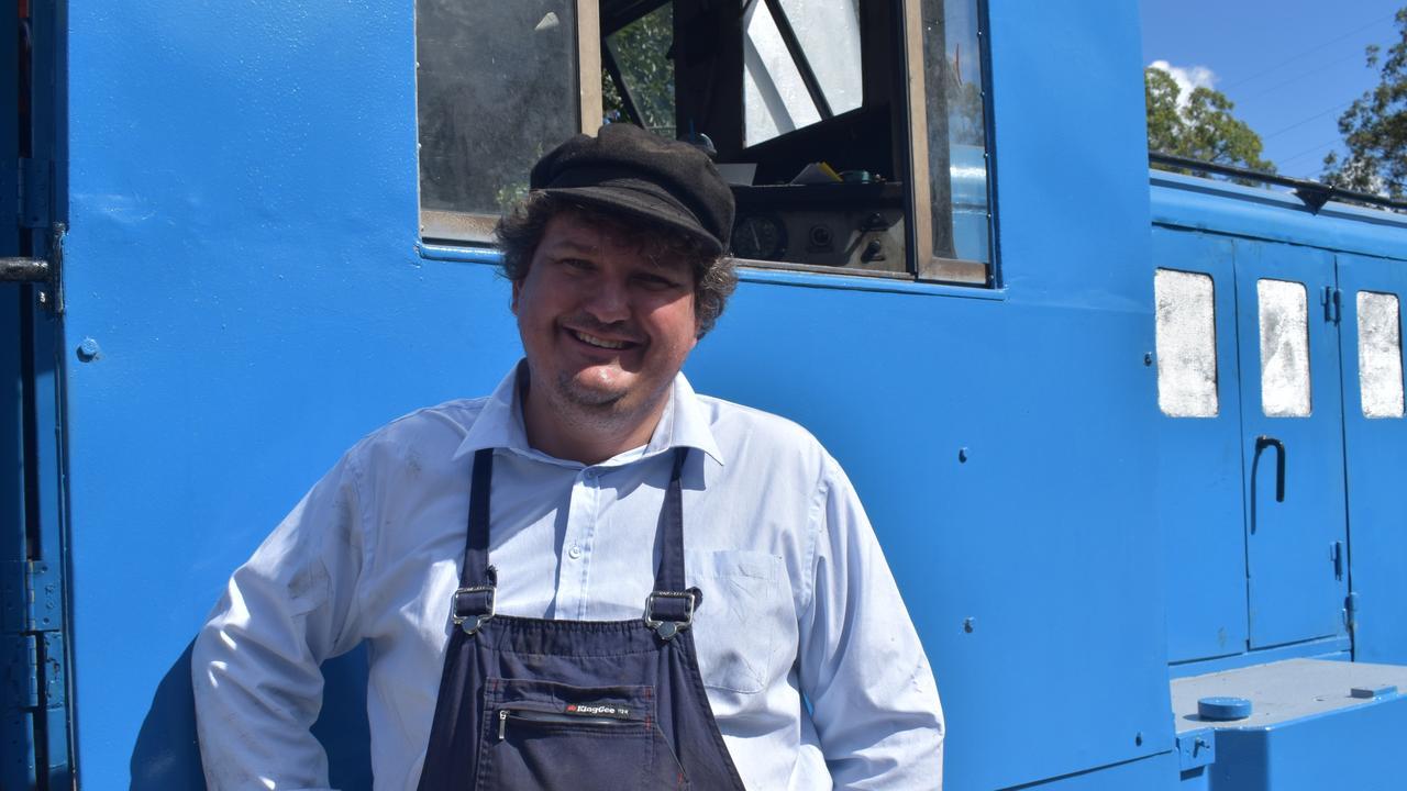 Queensland Pioneer Steam Railway chairman Robert Shearer with Bubba.