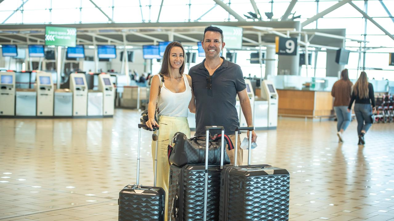 19-04-2021 Engaged Gold Coast couple Cassandra Lyons and Adam Hudson about to board the first flight to New Zealand as part of the travel bubble. PICTURE: Brad Fleet